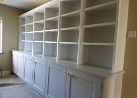 Bookcase with Storage Below Painted in a Light and Dark Grey