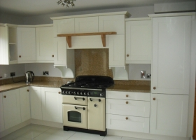 Cream Painted Kitchen with Brown Granite Tops
