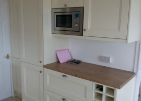 French Cut Ivory Kitchen with Integrated Microwave & Fridge