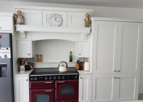 Wakefield Kitchen painted in Dust Grey and Porcelain with a Stellar Quartz Worktop with a Bespoke Canopy over Cooker